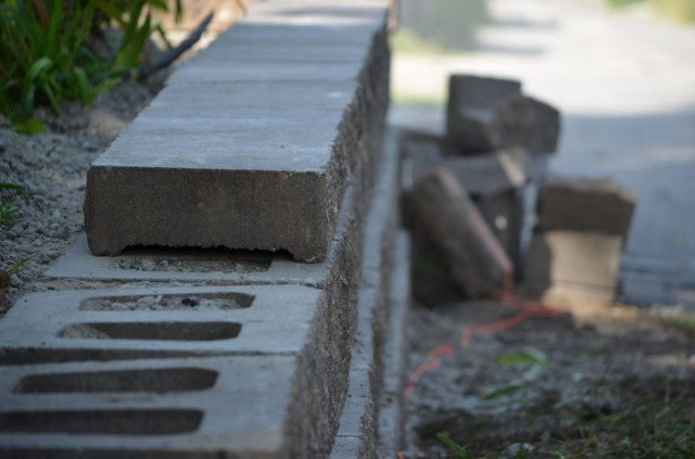 Landscape Block Construction Adhesive : The wall caps are secured to top blocks with a masonry adhesive